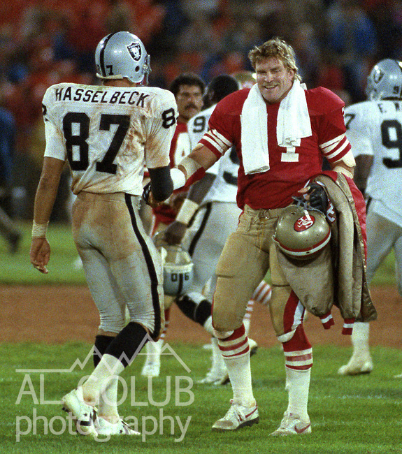 San Francisco 49ers vs. Los Angles Raiders at Candlestick Park Saturday, August 4, 1984..Pre-season Game. .San Francisco Tackle Keith Fahnhorst (71) greets Raider player after game...