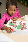 Education Preschool 3 year olds art activity gluing collages girl putting glue on paper