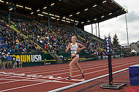 Mizzou freshman Kaitlyn Fischer crosses the finishline midway through the womens' 10k at the 2014 NCAA Division I Outdoor Track and Field Championships in Eugene, Oregon, Thursday, June12, 2014. Fischer held tough while others runners faded, eventualy moving up and finishing ninth in a 56-second personal best of 33:12.37, to just miss an NCAA trophy, but earning second team All-American honors.