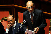 Il Presidente del Consiglio Enrico Letta parla durante la discussione sulla mozione di sfiducia nei confronti del Ministro dell'Interno e Vicepresidente del Consiglio Angelino Alfano, a sinistra, al Senato, Roma, 19 luglio 2013.<br /> Italian Premier Enrico Letta speaks during a plenary session for the discussion of a no confidence motion against Interior Minister and Deputy Premier Angelino Alfano, left, at the Senate in Rome, 19 July 2013.<br /> UPDATE IMAGES PRESS/Riccardo De Luca