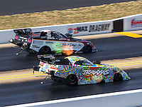 Sep 17, 2016; Concord, NC, USA; NHRA funny car driver Courtney Force (near) races alongside Tim Wilkerson during qualifying for the Carolina Nationals at zMax Dragway. Mandatory Credit: Mark J. Rebilas-USA TODAY Sports