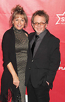WWW.BLUESTAR-IMAGES.COM Singer/songwriter Paul Williams (R) and Mariana Williams attend 2014 MusiCares Person Of The Year Honoring Carole King at Los Angeles Convention Center on January 24, 2014 in Los Angeles, California.<br /> Photo: BlueStar Images/OIC jbm1005  +44 (0)208 445 8588