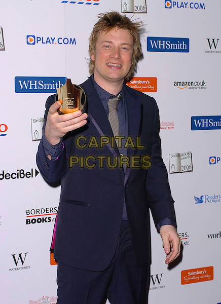 JAMIE OLIVER.British Book Awards at Grosvenor House, Park Lane, London, UK..March 29th, 2006.Ref: CAN.half length Outstanding Achievement Award winner trophy blue suit jacket .www.capitalpictures.com.sales@capitalpictures.com.© Capital Pictures.