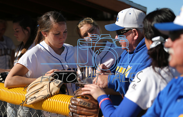 Wildcat Heather Septon talks with coaches during a college softball game against Salt Lake Community College on Friday, Feb. 15, 2013, in Carson City, Nev. SLCC won the opener 4-2..Photo by Cathleen Allison