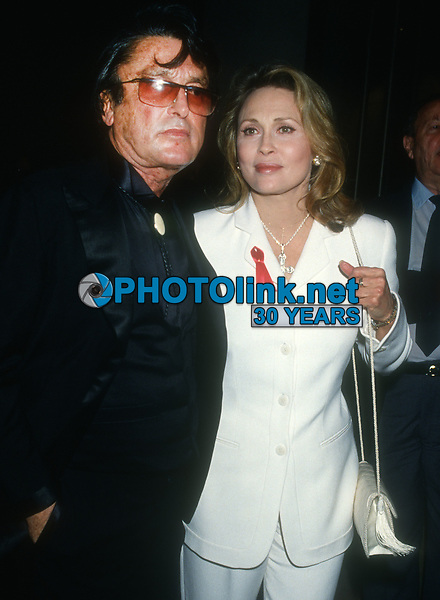Robert Evans Faye Dunaway<br /> 1993<br /> Photo By Michael Ferguson/PHOTOlink
