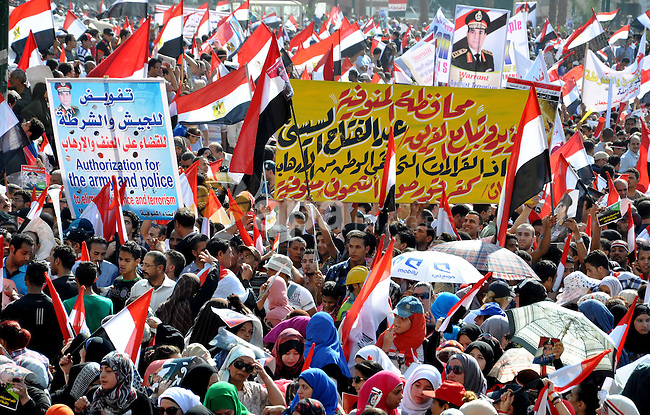 Egyptian protesters take part in a protest in support of the army, at Tahrir square, Cairo, Egypt, 26 July 2013. Egyptian authorities on 26 July ordered ousted president Mohammed Morsi to be detained for 15 days pending further investigations on charges of conspiring to carry out 'hostile acts' in the country, reported state-run newspaper al-Ahram online. Morsi's backers and opponents were, meanwhile, rallying for rival demonstrations across the country, mainly in Cairo. Scores of anti-Islamist activists were turning out at central Cairo's Tahrir Square in response to a call made by army chief Abdel-Fattah al-Sisi, who engineered Morsi's ouster. Photo by Ahmed Asad