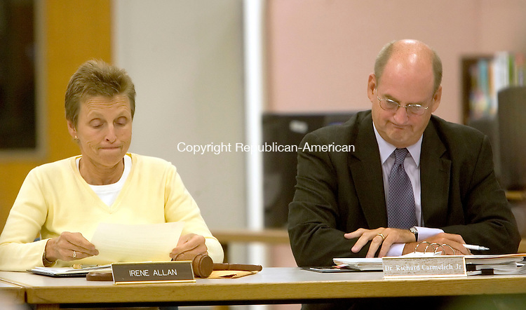WASHINGTON, CT-11 SEPTEMBER 2006-091106JS04-Region 12 Board of Education Chairman Irene Allan, left, reads a letter of resignation from school Superintendent Dr. Richard E. Carmelich, Jr,. during Monday's Board of Education meeting at Shepaug High School in Washington. Dr. Carmelich's retirement will be effective December 31, 2006.   -Jim Shannon Republican-American