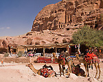 "A restaurant sits in the shadow of the famous ""urn tomb"", visible high on the rock wall at the Nabatean capital of Petra, Jordan.  © Rick Collier"