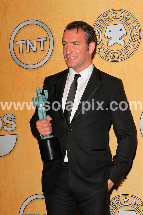 **ALL ROUND PICTURES FROM SOLARPIX.COM**                                             **SYNDICATION RIGHTS FOR UK, AUSTRALIA, DENMARK, PORTUGAL, S. AFRICA, SPAIN & DUBAI (U.A.E) & ASIA (EXCLUDING JAPAN) ONLY**                                                                                  Press Room arrivals for the 18th Annual Screen Actors Guild Awards at the Shrine Auditorium in Los Angeles, CA, USA                                                                .This pic:  Jean Dujardin.JOB REF:   14398    PHZ  Evans    DATE: 29.01.12                                                           **MUST CREDIT SOLARPIX.COM OR DOUBLE FEE WILL BE CHARGED**                                                                      **MUST AGREE FEE BEFORE ONLINE USAGE**                               **CALL US ON: +34 952 811 768 or LOW RATE FROM UK 0844 617 7637**