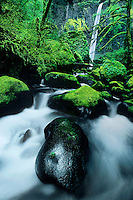 738600057 moss covered boulders frame elowah falls in the columbia river gorge national scenic area in oregon