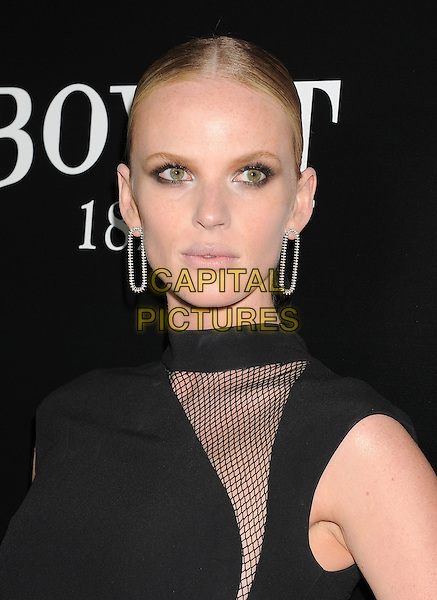 HOLLYWOOD, CA- FEBRUARY 27: Model Anne V arrives at the Hollywood Domino's 7th Annual Pre-Oscar Charity Gala at Sunset Tower on February 27, 2014 in West Hollywood, California.<br /> CAP/ROT/TM<br /> &copy;Tony Michaels/Roth Stock/Capital Pictures