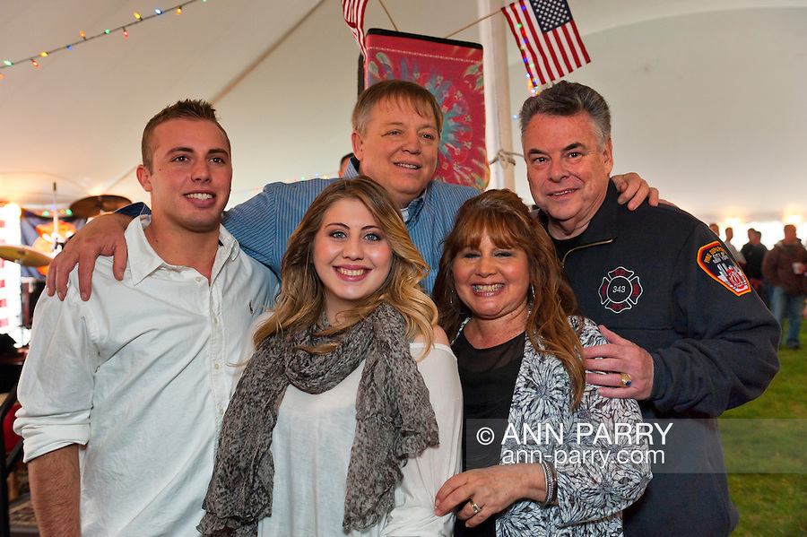 Fund raiser for firefighter Ray Pfeifer on Saturday, March 31, 2012, at East Meadow Firefighters Benevolent Hall, New York, USA. Congressman Pete King (rear, left) shown with Ray Pfeifer (rear middle) and the firefighter's wife, daughter Taylor, and son.