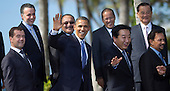 United States President Barack Obama and world leaders wave as they pose during the Asia-Pacific Economic Cooperation (APEC) family photo session at the J.W. Marriott Hotel in Honolulu, Hawaii on Sunday, November 13, 2011.  From left to right: President Dmitry Medvedev of Russia; Economy Secretary Bruno Ferrari of Mexico; President Obama; Prime Minister Peter O'Neill of Papua New Guinea; Prime Minister Yoshihiko Noda of Japan; President Benigo Aquino III of the Philippines; and Sultan of Brunei Hassanal Bolkiah..Credit: Kent Nishimura / Pool via CNP