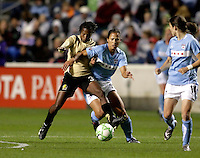 FC Pride midfielder Formiga (31) battles for the ball with Chicago Fire defender Jill Oakes (24).  The defeated the FC Gold Pride defeated the Chicago Red Stars 1-0 at Toyota Park in Bridgeview, IL on May 16, 2009.