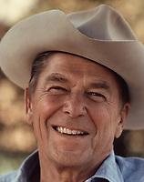 Ronald Reagan wearing cowboy hat at Rancho del Cielo, 1976<br /> <br /> PHOTO : Michael Evans