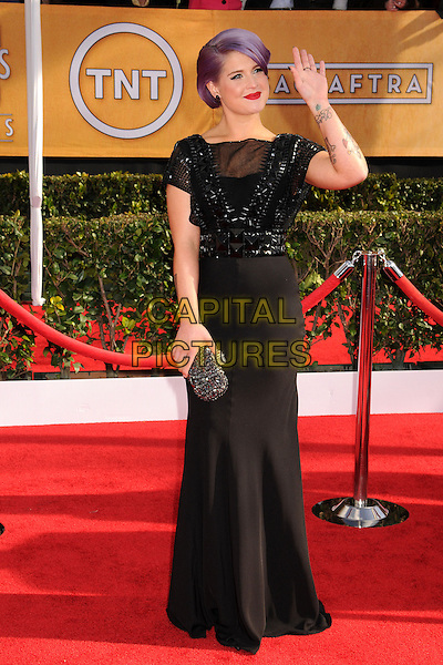 Kelly Osbourne.Arrivals at the 19th Annual Screen Actors Guild Awards at the Shrine Auditorium in Los Angeles, California, USA..27th January 2013.SAG SAGs full length black dress beads beaded hand on hip purple hair dyed clutch bag hand arm waving tattoos .CAP/ADM/BP.©Byron Purvis/AdMedia/Capital Pictures