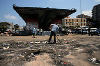 Beirut, July 15, 2006.Municipality workers have already cleaned up the ruble from a road overpass destroyed 24 hours earlier in Ghobeiri by an Israeli air attack.