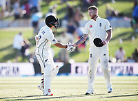 23rd November 2019; Mt Maunganui, New Zealand;  BJ Watling is congratulated by Ben Stokes on his century at the end on Day 3, 1st Test match between New Zealand versus England. International Cricket at Bay Oval, Mt Maunganui, New Zealand.  - Editorial Use