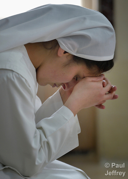 Diana Sakaria, a novice in the Dominican Sisters of St. Catherine of Siena, prays in the chapel of the congregation's convent in Ankawa, near Erbil, Iraq. The sisters were displaced by ISIS in 2014, and carry out a variety of ministries among the displaced in northern Iraq.
