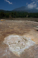 A stain left by a body on the floor of what was once a home in an area of Panabaj, Guatemala on Tuesday, March 20, 2007. A deadly mudslide here was spawned by rains associated with Hurricane Stan in October 2005. Initially, up to 500 Tzujutil Maya villagers were believed to have been killed by the mudslide, which essentially  wiped away the town. Forensic anthropologists from the Fundación de Antropología Forense de Guatemala have been working to unearth the bodies of the missing and have recovered more than 100. They have also found the number of missing to be lower than originally thought, after many people were located in shelters or living in other towns after the disaster.