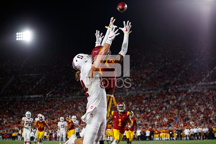 LOS ANGELES, CA - SEPTEMBER 8: USC Trojans safety Dorian Hewett #22 breaks up an end zone pass intended for Stanford Cardinal tight end Colby Parkinson #84 during a game between USC and Stanford Football at Los Angeles Memorial Coliseum on September 7, 2019 in Los Angeles, California.