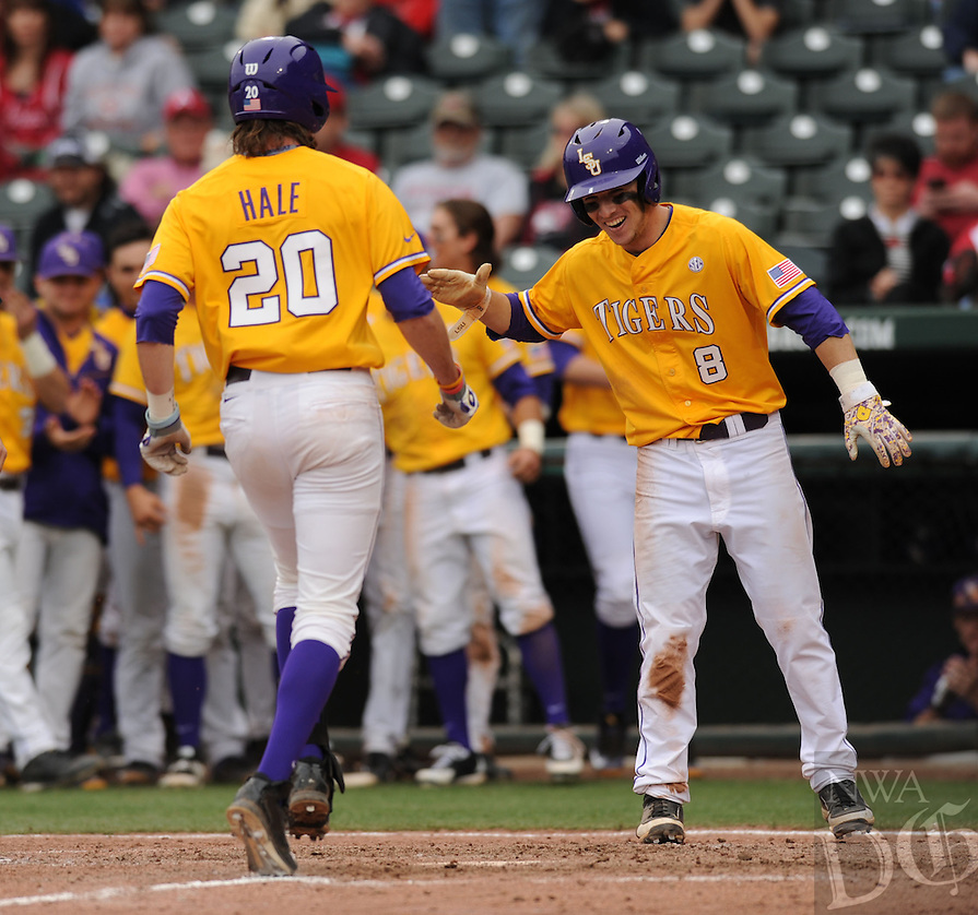NWA Democrat-Gazette/ANDY SHUPE - Conner Hale (20) of LSU is congratulated by Alex Bregman at the plate after hitting a 2-run home run during the ninth inning against Arkansas Saturday, March 21, 2015, at Baum Stadium in Fayetteville. Visit nwadg.com/photos for more photos from the game.