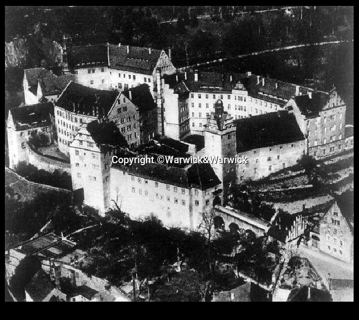 BNPS.co.uk (01202 558833)<br /> Pic: Warwick&Warwick/BNPS<br /> <br /> Colditz Castle during the war.<br /> <br /> A remarkable archive of photos which provide a glimpse inside the infamous Colditz Castle has come to light.<br /> <br /> The photos show the ingenuity of the Allied POWs who devised ever-bolder ways to escape from the German stronghold during World War Two.<br /> <br /> One image is of a dummy they would hold up to trick the German guards into believing the escaper was still with them during parade head counts. Others reveal the tunnels which were dug using tools smuggled into the 11th century castle in care parcels.<br /> <br /> The photos were taken by the official Colditz photographer Johannes Lange, who was employed by the German Army to take pictures of failed Allied escape attempts. They were then distributed to other POW camps to alert the guards to the methods the inmates were using in their bids for freedom.<br /> <br /> The archive is being sold by a private collector with auctioneer Warwick & Warwick, with an estimate of £1,750.