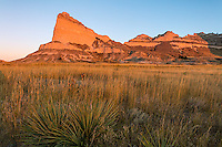 Scotts Bluff National Monument, Nebraska: Scotts Bluff rises above prairie grasses at sunrise.
