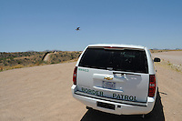 Nogales, Arizona - A Border Patrol vehicle parked near the international U.S.-Mexico border. The vehicle was part of a caravan that took journalists to the border in an event sponsored by the U.S. Customs and Border Protection agency. This area is near the Border Patrol Nogales station, one of eight in the Tucson Sector, which is the busiest on the U.S.-Mexico border for illegal immigration, drug smuggling and border deaths. Photo by Eduardo © 2012