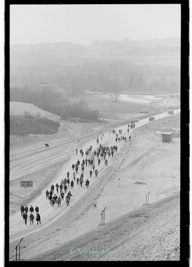 protesters march along  the  route earth of the . M3 extension Winchester.  Twyford down
