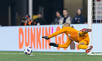 Foxborough, Massachusetts - April 6, 2018: In a Major League Soccer (MLS) match, New England Revolution (blue/white) defeated,4-0, Montreal Impact (white), at Gillette Stadium.<br /> Penalty kick save.