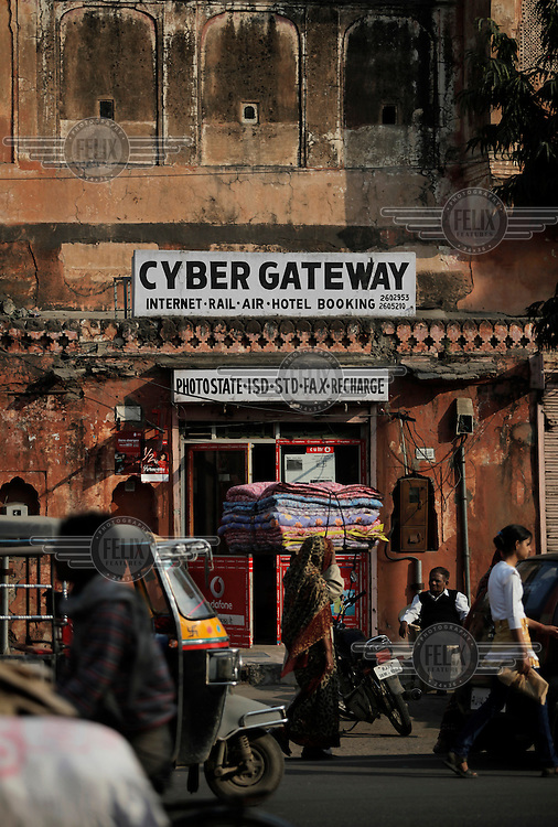 Cyber Gateway, a small shop in the historic part of Jaipur, offering various travel and telecom services.