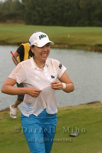 February 18, 2006; Kahuku, HI - Joo Mi Kim is all wet after jumping in the water at the 18th hole after winning the LPGA SBS Open at Turtle Bay Resort...Mandatory photo credit: Darrell Miho.© Darrell Miho