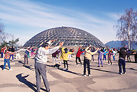 Vancouver, BC, British Columbia, Canada - Tai Chi Keep Fit Exercise Class outside Bloedel Floral Conservatory in Queen Elizabeth Park, Spring