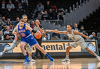 WASHINGTON, DC - DECEMBER 28: Terrell Allen #12 and Omer Yurtseven #44 of Georgetown defend against Mark Gasperini #23 of American during a game between American University and Georgetown University at Capital One Arena on December 28, 2019 in Washington, DC.