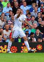 Saturday 15 September 2012<br /> Pictured: Angel Rangel of Swansea vents his anger against a team mate after one of his crosses was spoiled.<br /> Re: Barclay's Premier League, Aston Villa v Swansea City FC at Villa Park, West Midlands, UK.