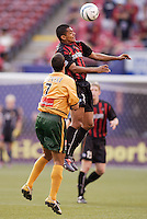 The MetroStars' Amado Guevara goes up for a header in front of  the Galaxy's Jovan Kirovski. The NY/NJ MetroStars defeated the LA Galaxy 3 to 0 during MLS action at Giant's Stadium, East Rutherford, NJ, on August 8, 2004.