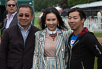 King Power CEO and Leicester City Owner Vichai Srivaddhanaprabha (left) with his son Apichet Srivaddhanaprabha (King Power) (right) during the Cartier Queens Cup Final match between King Power Foxes and Dubai Polo Team at the Guards Polo Club, Smith's Lawn, Windsor, England on 14 June 2015. Photo by Andy Rowland.
