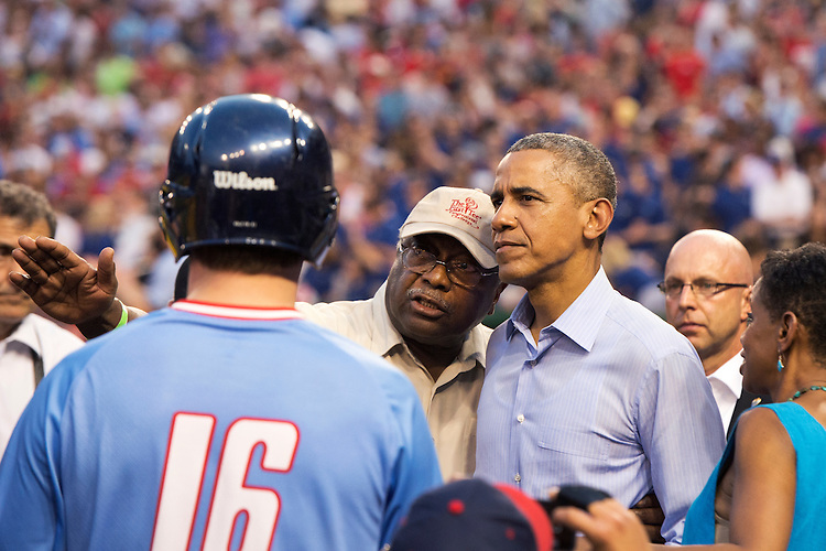 UNITED STATES - JUNE 11: President Barack Obama talks with Rep. James Clyburn, D-S.C., during the 54th Congressional Baseball Game in Nationals Park, June 11, 2015. The Democrats prevailed over the Republicans 5-2. (Photo By Tom Williams/CQ Roll Call)