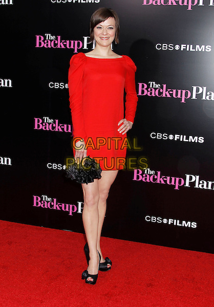 "MARIBETH MONROE .""The Back-up Plan"" Los Angeles Premiere held at the Regency Village Theatre, Westwood, California, USA, 21st April 2010. .arrivals full length red dress shoulder pads ruched sleeves sleeve long black clutch bag peep toe shoes roses rosettes rosette.CAP/ADM/MJ.©Michael Jade/AdMedia/Capital Pictures."