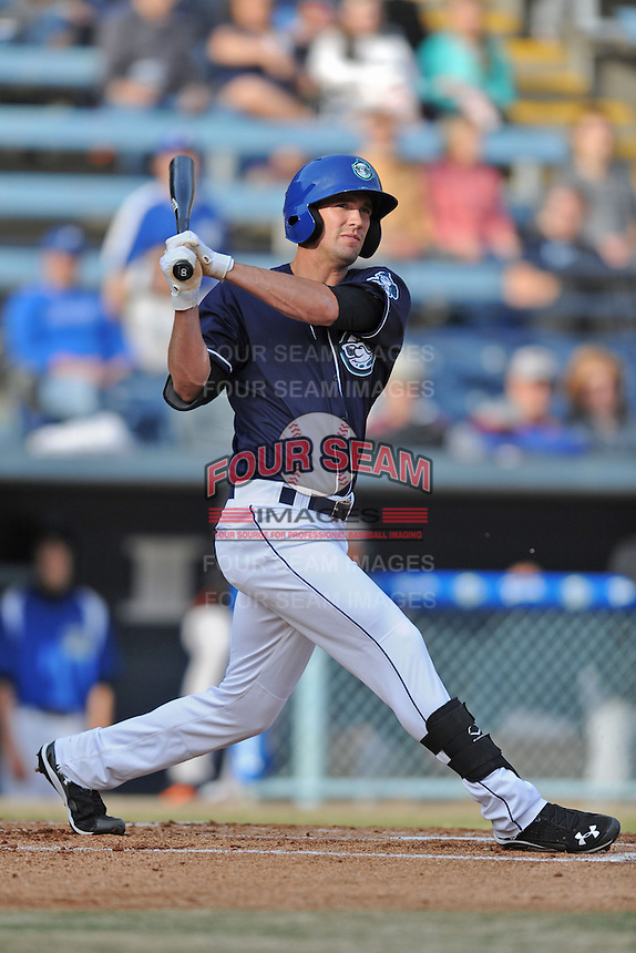 Asheville Tourists center fielder David Dahl #21 swings at a pitch during a game against the Delmarva Shorebirds at McCormick Field on April 5, 2014 in Asheville, North Carolina. The Tourists defeated the Shorebirds 5-3. (Tony Farlow/Four Seam Images)
