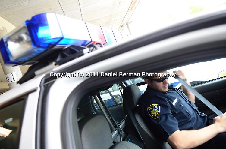 Western Washington University Police Officer Derek Jones buckles up as he enters his vehicle Friday May 13, 2011. Photo by Daniel Berman/University Communications intern