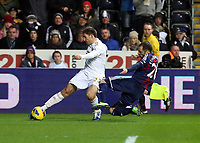Saturday 19 January 2013<br /> Pictured L-R: Angel Rangel of Swansea tackled by Matthew Etherington of Stoke.<br /> Re: Barclay's Premier League, Swansea City FC v Stoke City at the Liberty Stadium, south Wales.