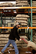 December 20, 2011. Durham, NC.. Bags of green coffee wait in the warehouse to be roasted.. With the rising price of coffee worldwide and new fair trade regulations making it more difficult to get ethically traded coffee, how does local roaster Counter Culture maintain their mission and ethics?.