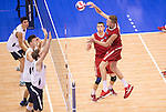 07 MAY: Blake Leeson (11) of Ohio State University goes for a kill against Brigham Young University during the Division I Men's Volleyball Championship held at Rec Hall on the Penn State University campus in University Park, PA. Ohio State defeated BYU 3-1 for the national title. Ben Solomon/NCAA Photos