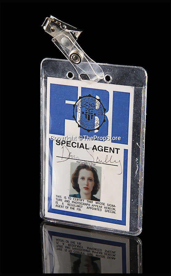 BNPS.co.uk (01202 558833)<br /> Pic: ThePropStore/BNPS<br /> <br /> Gillian Anderson's Dana Scully FBI ID from The X-Files.<br /> <br /> Stop! Police! - Hollywoods finest...and funniest id badges come up for auction.<br /> <br /> The world's largest ever collection of IDs belonging to a who's who of film and TV stars is set to be auctioned. <br /> <br /> Credentials used by Hollywood royalty including Jodie Foster, Bruce Willis, Leonardo DiCaprio, Jeremy Irons, Eddie Murphy and Kiefer Sutherland are all about to go under the hammer. <br /> <br /> The lots are being sold on behalf of an anonymous collector who amassed the collection over a period of 15 years. <br /> <br /> They will be auctioned by the Prop Store in London on Tuesday, September 27.
