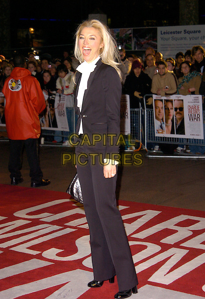 TAMARA BECKWITH .Charlie Wilson's War - UK film premiere, Empire Leicester Square, London, England..January 9th, 2008.full length black suit mouth open funny face .CAP/CAN.©Can Nguyen/Capital Pictures