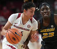 NWA Democrat-Gazette/J.T. WAMPLER Arkansas' Jailyn Mason drives to the basket as Missouri's Amber smith defends Monday Feb. 12, 2018 at Bud Walton Arena in Fayetteville.