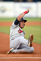 Brevard County Manatees  third baseman Brandon Macias (22) slides into third during a game against the Lakeland Flying Tigers on April 10, 2014 at Joker Marchant Stadium in Lakeland, Florida.  Lakeland defeated Brevard County 6-5.  (Mike Janes/Four Seam Images)