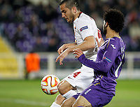 Calcio, Europa League: Andata degli ottavi di finale Fiorentina vs Roma. Firenze, stadio Artemio Franchi, 12 marzo 2015.<br /> Roma's Kostas Manolas, left, is challenged by Fiorentina's Mohamed Salah during the Europa League round of 16 first leg football match between Fiorentina and Roma at Florence's Artemio Franchi stadium, 12 March 2015.<br /> UPDATE IMAGES PRESS/Isabella Bonotto